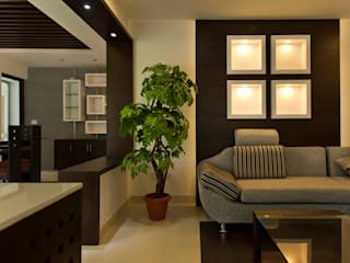 Dr Saji house:  Living room by S Squared Architects Pvt Ltd.