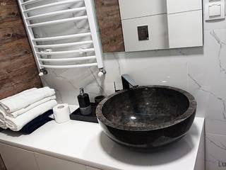 Okrągła umywalka z kamienia na blat - czarna: styl , w kategorii Łazienka zaprojektowany przez Lux4home™