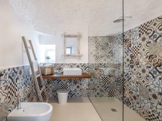 Baños de estilo  por ABBW angelobruno building workshop