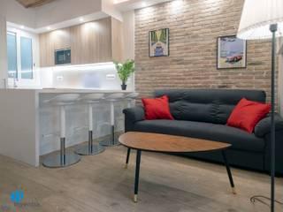 Grupo Inventia Salas de estilo moderno Ladrillos Marrón