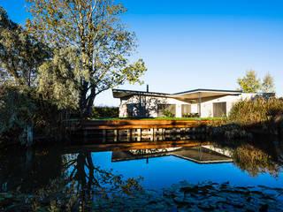 Casas de campo de estilo  por Schandl Architekten