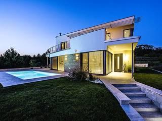 Casas unifamiliares de estilo  por Schandl Architekten