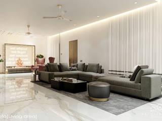 Mr Aditya Residency :  Living room by Raj Creation