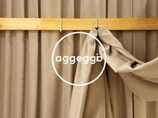 ENSEADA: Oficinas y Tiendas de estilo  por aggeggio