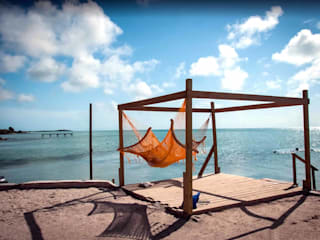 Ambergris Caye:  Wooden houses by LX Belize Real Estate
