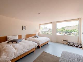 コンテナハウス/BEDROOM: ON FOCUS株式会社が手掛けたホテルです。
