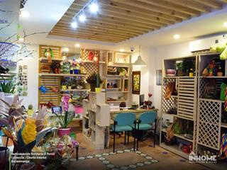 REMODELACIÓN FLORISTERÍA EL PENSIL: Oficinas y Tiendas de estilo  por INHOME , Clásico