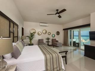 Dormitorios tropicales de AC Construcciones Tropical