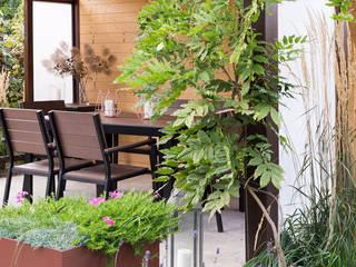 Nowoczesny ogród z altaną od Naturalnie - Studio Projektowe