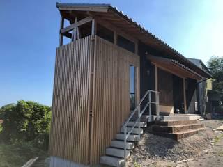 (有)クエストワークス一級建築士事務所 Single family home Wood Wood effect