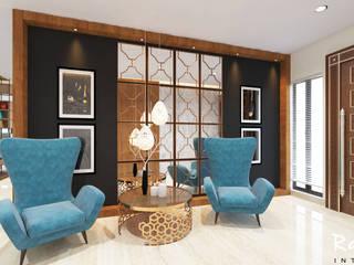 Mr.Raghava :  Living room by RAYON INTERIORS