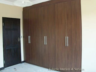 Wardrobes for bedroom and free spaces:   by ECLECTIC INTERIORS AND SERVICES