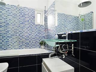 apartamento monte estoril: Casas de banho  por soulplace