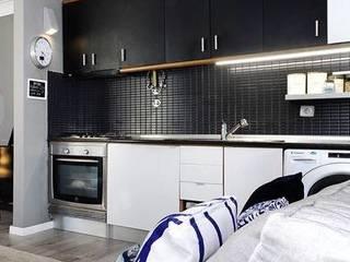 apartamento monte estoril: Cozinhas  por soulplace