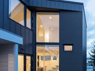 Unison: 富谷洋介建築設計が手掛けた壁です。