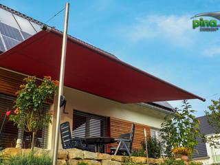Pina GmbH - Sonnensegel Design Balcone, Veranda & Terrazza in stile moderno Rosso