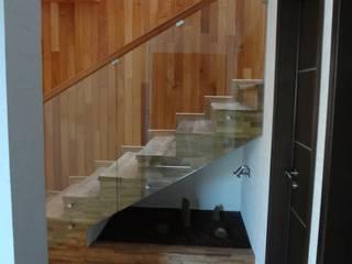 Casa habitación en la ciudad de Morelia.: Escaleras de estilo  por ARQUITECTOS UNION SC DE RL DE CV