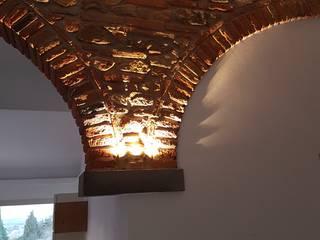 Illuminazione d'effetto Soggiorno in stile rustico di FBC srl.s Rustico