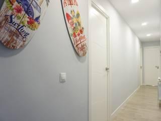 Reforma integral de un piso en Madrid : Pasillos y vestíbulos de estilo  de GRUPO STYLO REFORMAS Y DECORACIÓN S.L.