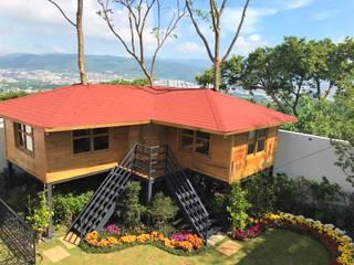 CASA DEL ARBOL Casas clásicas de Casas y cabañas de Madera -GRUPO CONSTRUCTOR RIO DORADO (MRD-TADPYC) Clásico