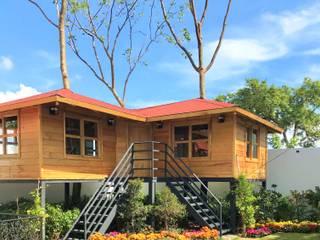 Rumah oleh Casas y cabañas de Madera  -GRUPO CONSTRUCTOR RIO DORADO (MRD-TADPYC)