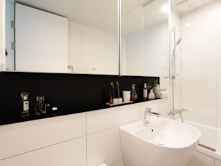 Baños de estilo moderno de 더집디자인 (THEJIB DESIGN) Moderno