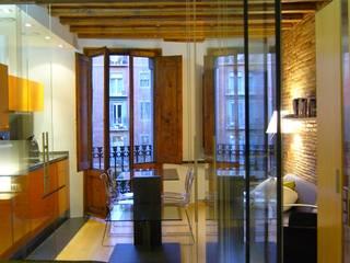 Loft Ramalleres: Salones de estilo  de ESTUDIO DE CREACIÓN JOSEP CANO, S.L.,