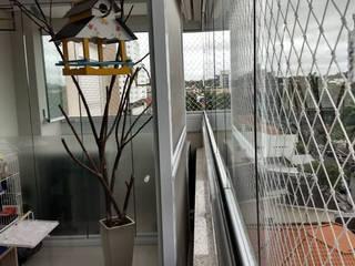 Varandas e churrasqueiras por Cristina Reyes Design de Interiores Moderno