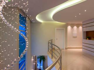 Casa Alphaville Piracicaba por Designer de Interiores e Paisagista Iara Kílaris Moderno