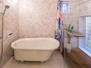 原山Y邸: 株式会社アートアーク一級建築士事務所が手掛けた浴室です。