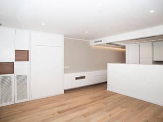 Grupo Inventia Salas de estilo moderno Concreto Blanco