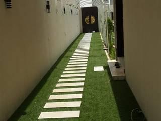 Jardines delanteros de estilo  de تنسيق الحدائق , Clásico