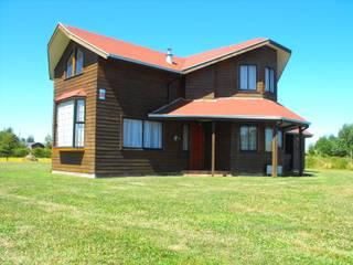 منزل عائلي صغير تنفيذ Nomade Arquitectura y Construcción spa