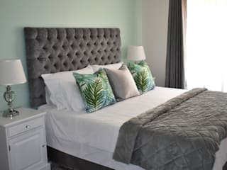 Tropical haven:  Bedroom by Tamsyn Fowler Interiors,