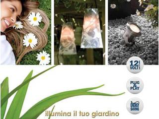 Esposizione serre Giardini Margherita Bologna:  in stile  di ILLUMINAZIONE GIARDINI di M.V. SAS
