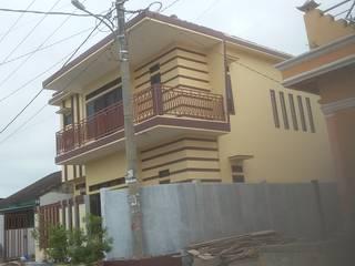 Rumah Pribadi Ibu Erda MODE KARYA Rumah tinggal Beton Bertulang Yellow