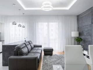 Beton architektoniczny w salonie Nowoczesne ściany i podłogi od Luxum Nowoczesny