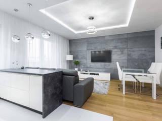 Beton architektoniczny w salonie Nowoczesny salon od Luxum Nowoczesny