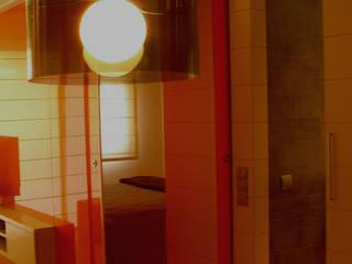 Espacio Singular Av. Lluís Companys: Salones de estilo  de ESTUDIO DE CREACIÓN JOSEP CANO, S.L.,
