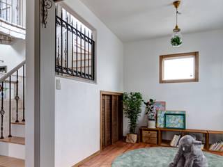 家族の家が弾ける家を〜Y様邸〜 クラシックデザインの リビング の 有限会社グリーンアンドハウス クラシック