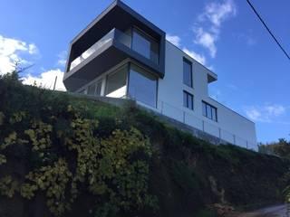 Moradia das Veigas Casas modernas por Engebasto - Atividades de Engenharia e Arquitetura, Lda Moderno