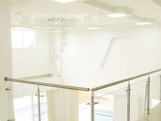Salas de estilo  por Am arquitectura