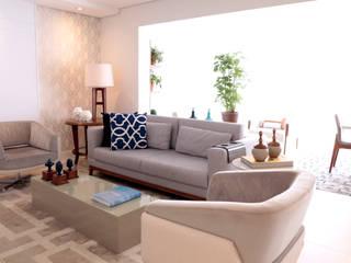 Projeto de arquitetura de interiores em apartamento de 124 m². Haus Brasil Arquitetura e Interiores Salas de estar modernas