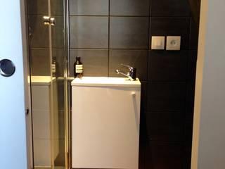 Studio Paris 17 Salle de bain classique par Casamo Classique