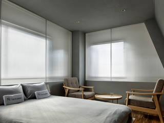 目白通りのアパートメントホテル  Ⅰ: 西谷隆建築計画事務所が手掛けた商業空間です。,