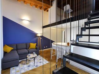 Rénovation complète d'un appartement en plein coeur de Lyon.: Salon de style  par Tiffany FAYOLLE