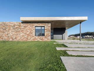 Casa Arenas del Sur Lote 23: Casas unifamiliares de estilo  por Estudio Ciannamea Arquitectura