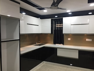 Contemporary Home Interiors By DEEJOS Modern kitchen by DEEJOS Interiors Pvt Ltd Modern