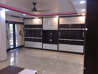 Contemporary Home Interiors By DEEJOS Modern style bedroom by DEEJOS Interiors Pvt Ltd Modern