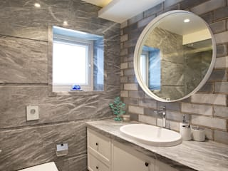 Bathroom:  Bathroom by Finelines Designers Private Limited